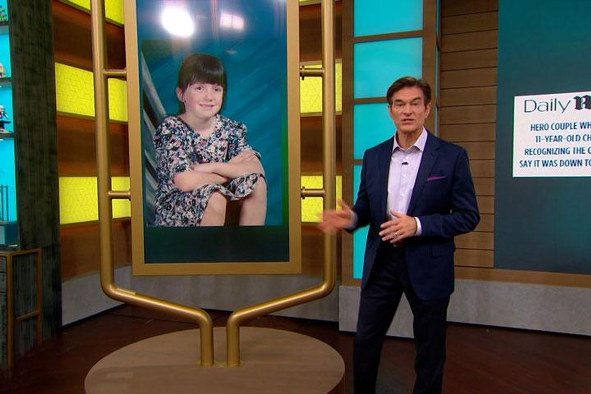 Dr. Oz stands in his studio in front of a photo of Amber Hagerman, who was kidnapped and killed at 9 years old in 1996.