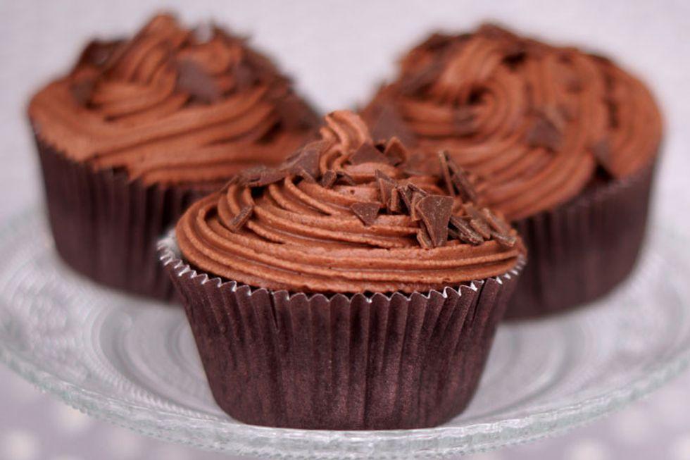 Vanilla Cupcakes With Raspberry Jam Topped With Chocolate Ganache