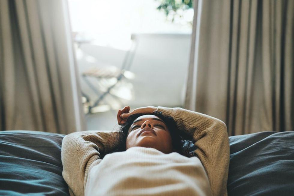 Photo of a Black woman asleep.
