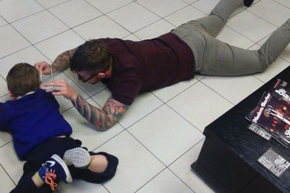 Barber Sits on the Floor in Order to Successfully Cut an Autistic Boy's Hair