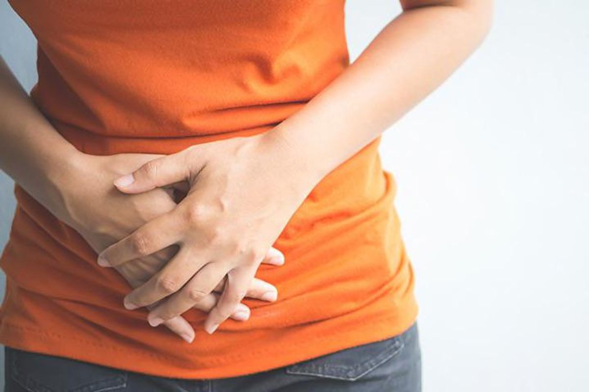 woman bloated holding stomach