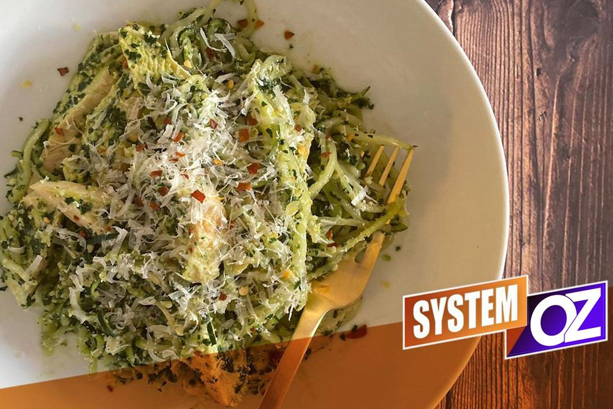 On System Oz, you'll eat filling meals like this grilled chicken with walnut pesto and zoodles.