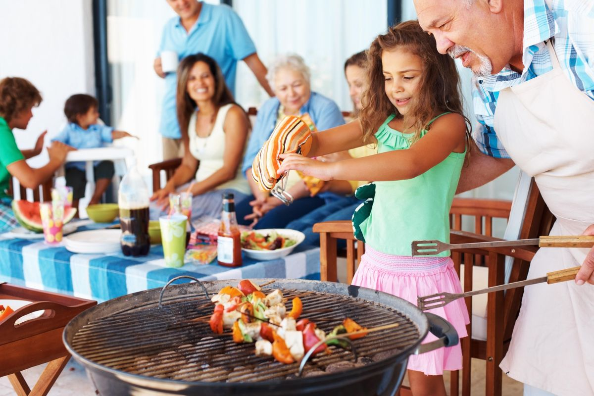 A family enjoys cookout food, which can lead to indigestion. But that can be relieved with the help of a probiotic supplement.